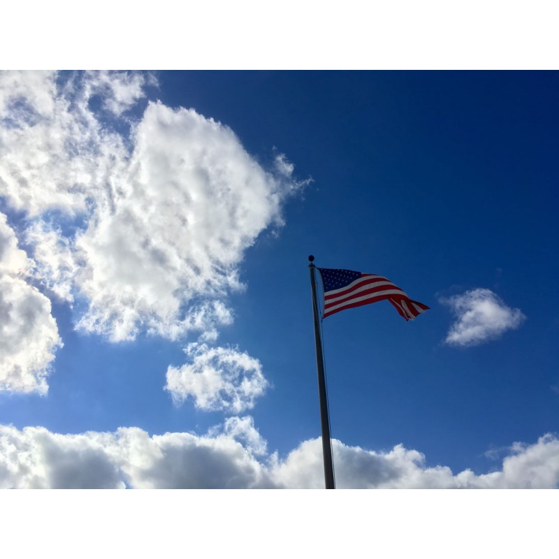 American Flag on a blue, blue sky - photo print - Primary Image