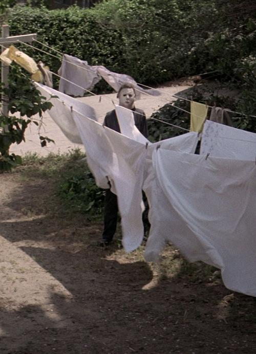 Michael Myers behind the clothes line