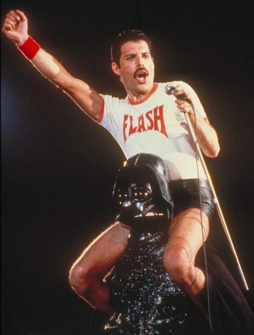 Freddie Mercury riding on the shoulders