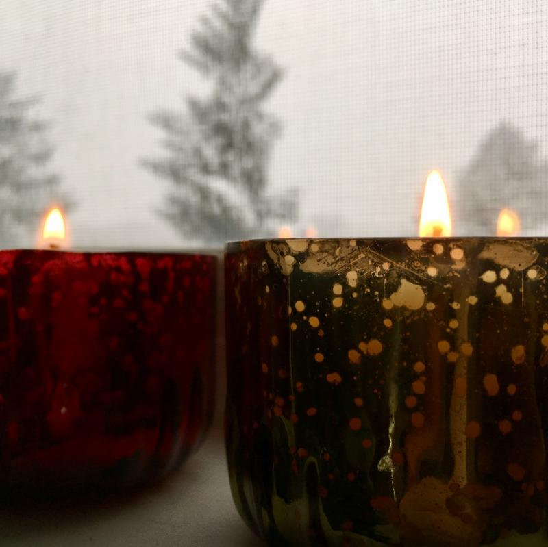 Red and green Christmas candles - daytime