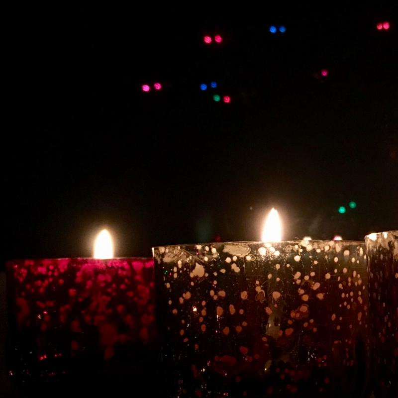 Red and green Christmas candles - nighttime