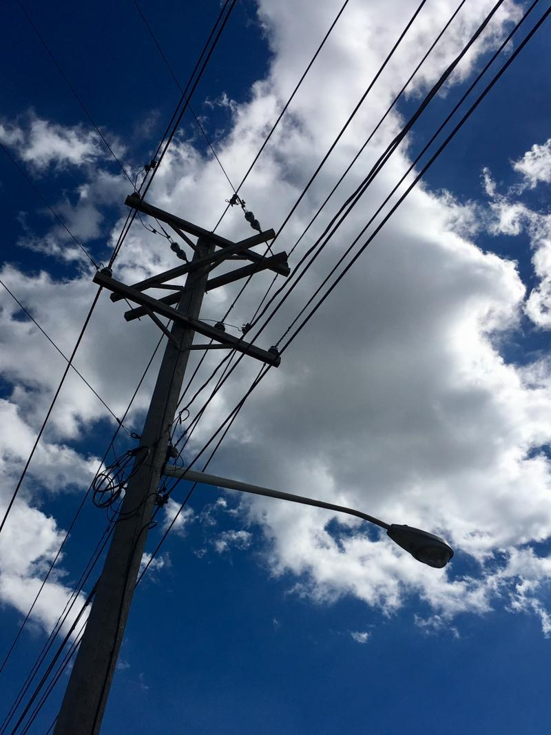 Telephone poles against blue skies 3
