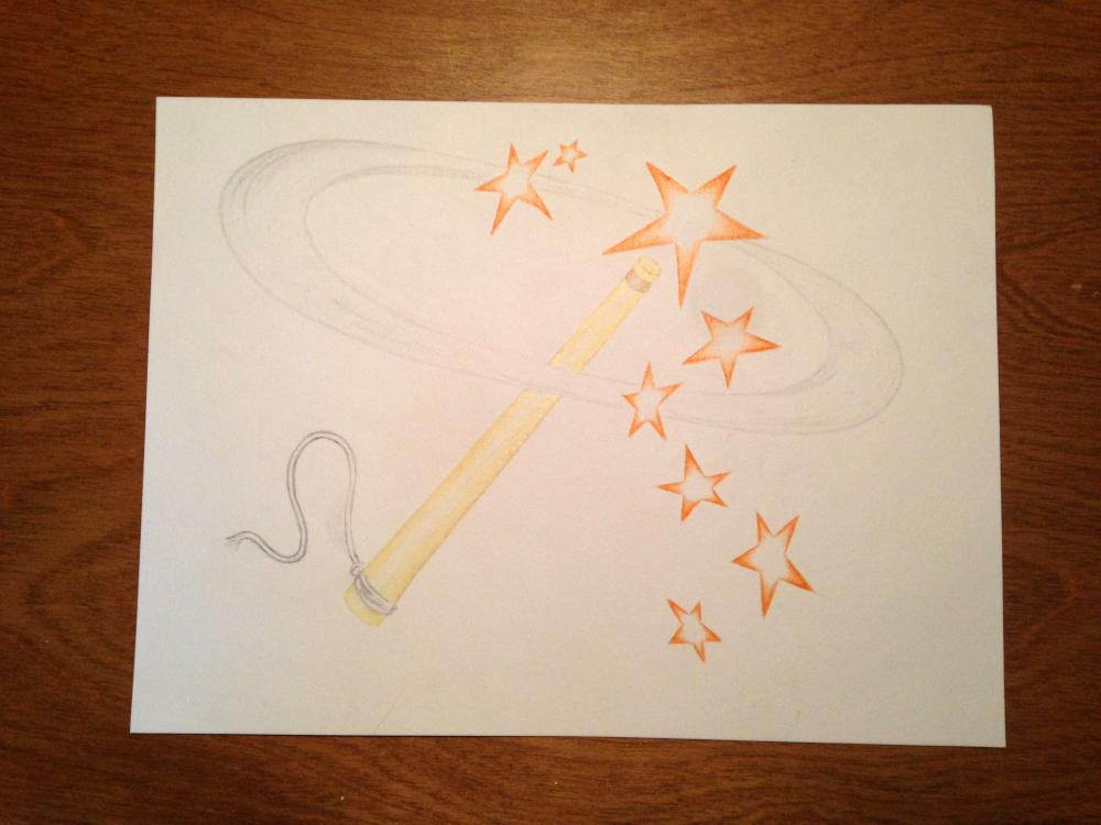 Magic wand with orange stars