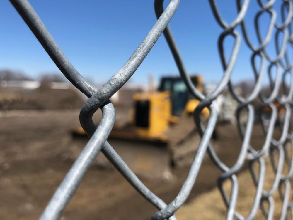 Bulldozer behind the chain link