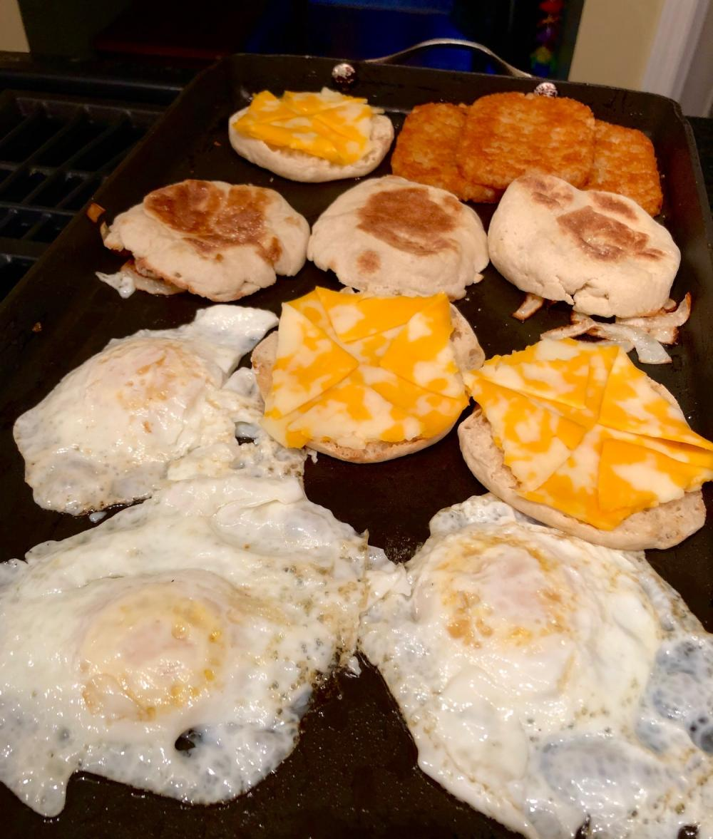 3 eggs and 3 hashbrowns and 3 english muffins with cheese
